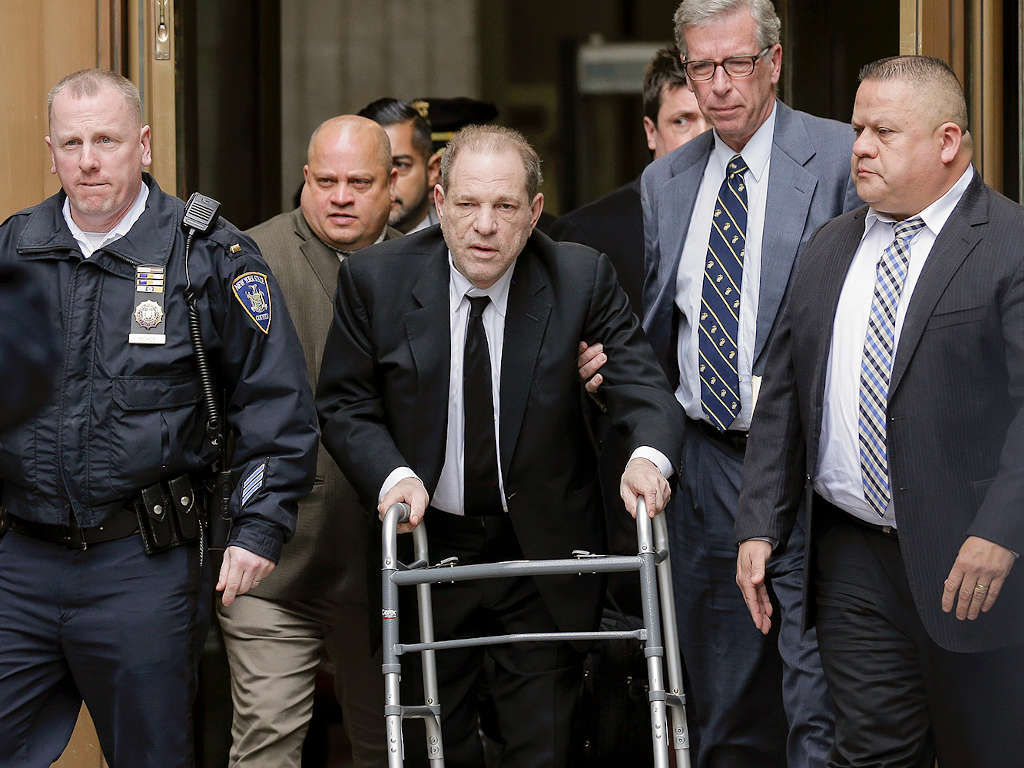 Harvey Weinsten (middle) seen here leaving a New York court in January 2020.