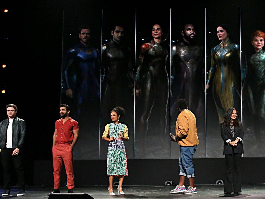 """Kumail Nanjiani (second from left, in red) is one of the stars in Marvel's """"Eternals""""."""