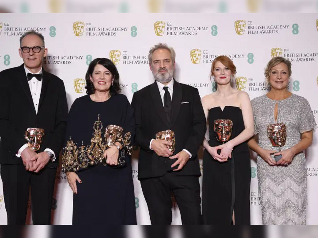 """The """"1917"""" team, Callum McDougall, Pippa Harris, Sam Mendes, Krysty Wilson-Cairns and Jayne-Ann Tenggren, posing with their awards for Outstanding British Film."""