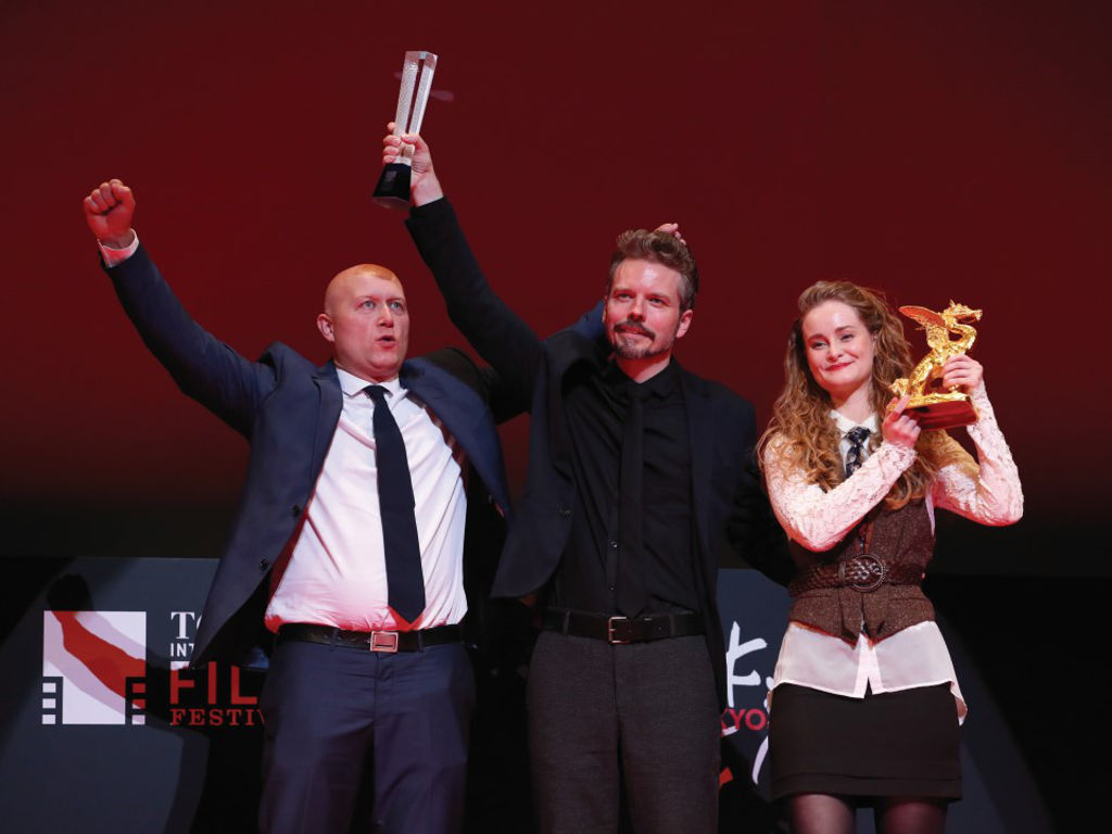 """Winners for the Danish film, """"Uncle"""", accepting the Tokyo Grand Prix prize."""