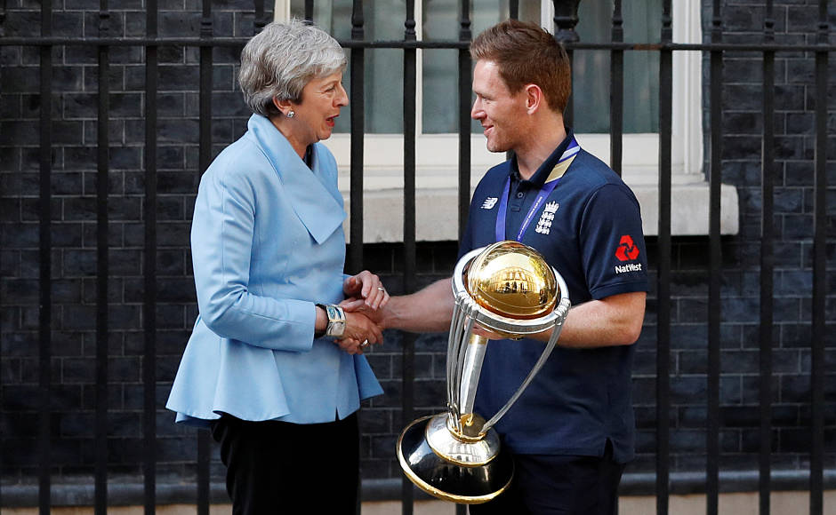 England skipper Eoin Morgan shakes hands with Theresa May. Reuters