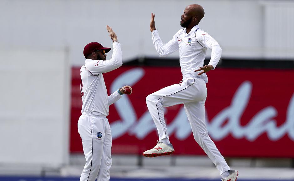 West Indies' Roston Chase celebrates the dismissal of India captain Virat Kohli. Kohli was dismissed for 51 runs. AP