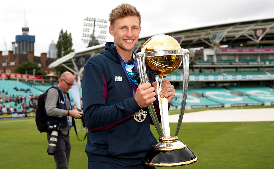 England's Joe Root poses for a picture with the World Cup trophy. Reuters