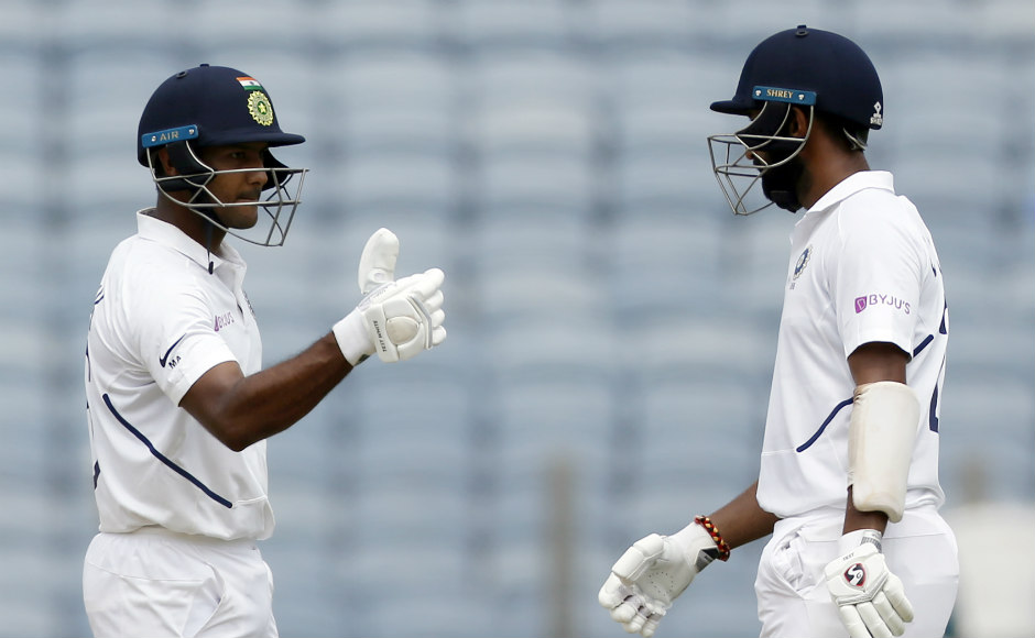 Mayank Agarwal and Cheteshwar Pujara forged a 138-run stand after Rohit Sharma's exit to put the hosts back in control. AP