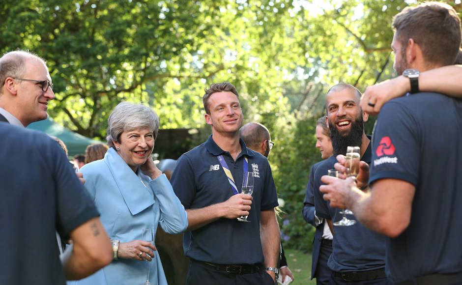 Theresa May, Jos Buttler and Moeen Ali are all smiles in this picture. Reuters