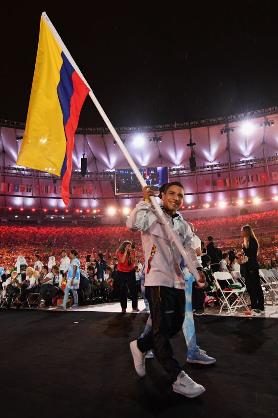 RIO DE JANEIRO, BRAZIL - SEPTEMBER 18: Gold, silver and bronze medalist Carlos Daniel Serrano carries the flag for Colombia during the closing ceremony of the Rio 2016 Paralympic Games at Maracana Stadium on September 18, 2016 in Rio de Janeiro, Brazil. (Photo by Atsushi Tomura/Getty Images for Tokyo 2020)