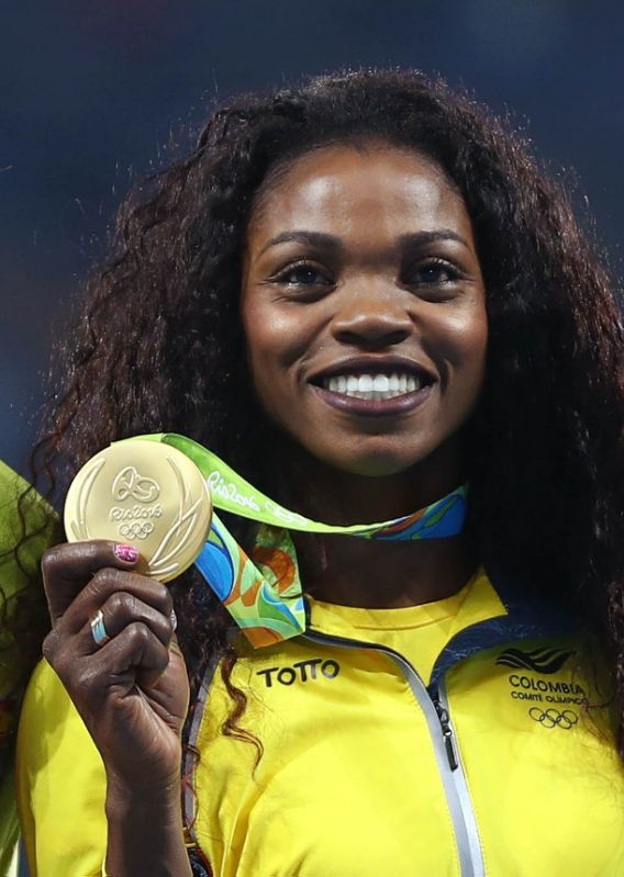 2016 Rio Olympics - Athletics - Victory Ceremony - Women's Triple Jump Victory Ceremony - Olympic Stadium - Rio de Janeiro, Brazil - 15/08/2016. Gold medalist Caterine Ibarguen (COL) of Colombia reacts after receiving her medal. REUTERS/Leonhard Foeger FOR EDITORIAL USE ONLY. NOT FOR SALE FOR MARKETING OR ADVERTISING CAMPAIGNS.