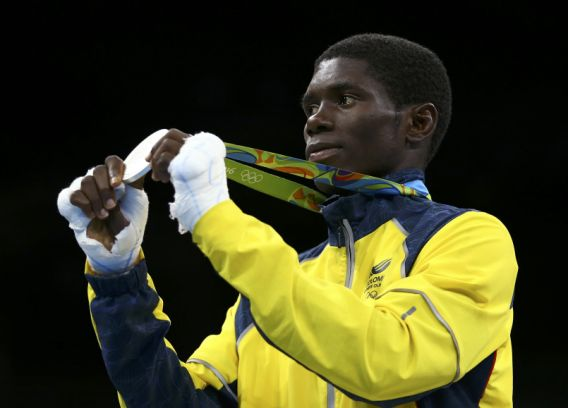2016 Rio Olympics - Boxing - Victory Ceremony - Men's Light Fly (49kg) Victory Ceremony - Riocentro - Pavilion 6 - Rio de Janeiro, Brazil - 14/08/2016. Yuberjen Martinez Rivas (COL) of Colombia poses with his silver medal during the victory ceremony. REUTERS/Peter Cziborra FOR EDITORIAL USE ONLY. NOT FOR SALE FOR MARKETING OR ADVERTISING CAMPAIGNS