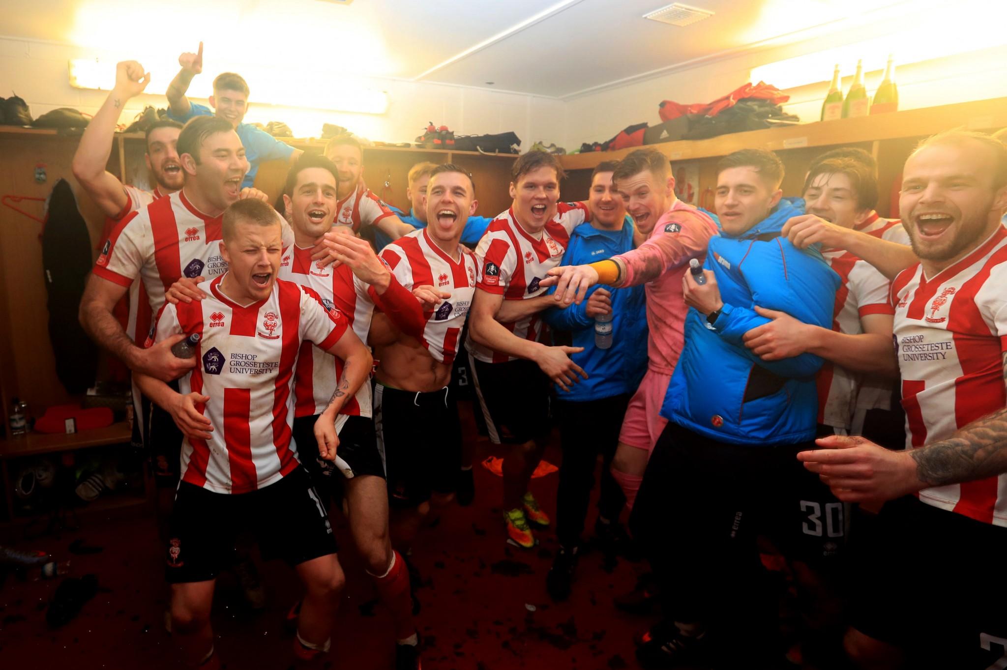 Lincoln celebrate their round 4 defeat of Brighton