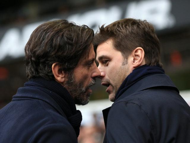 Watford manager Quique Sanchez Flores speaks to Pochettino during their Premier League match at White Hart Lane (Adam Davy/PA)