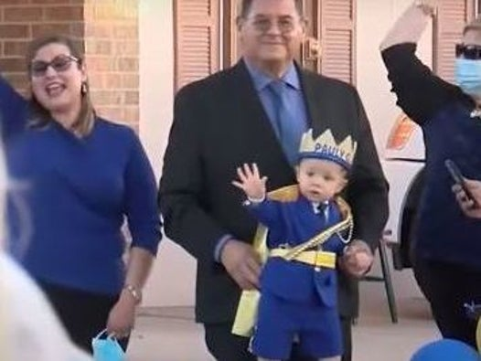 Hundreds take part in parade to mark first birthday of boy who lost both parents in El Paso shooting