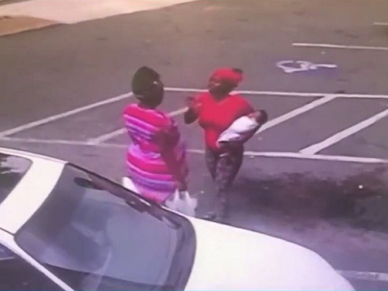 Mother killed baby by dropping her during street fight, police say