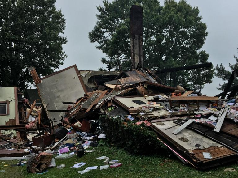 Explosion at interracial couples home treated as hate crime after swastika painted on garage