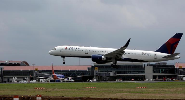 Delta airlines flight makes emergency landing after broken plane part flies into engine after takeoff