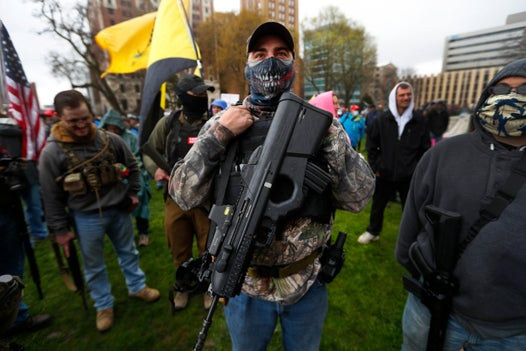 Armed lockdown protestors who stormed Michigan Capitol represent 'worst racism and awful parts' of US history, governor says