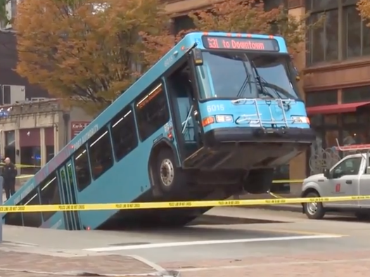 Sinkhole swallows half of Pittsburgh bus during rush hour