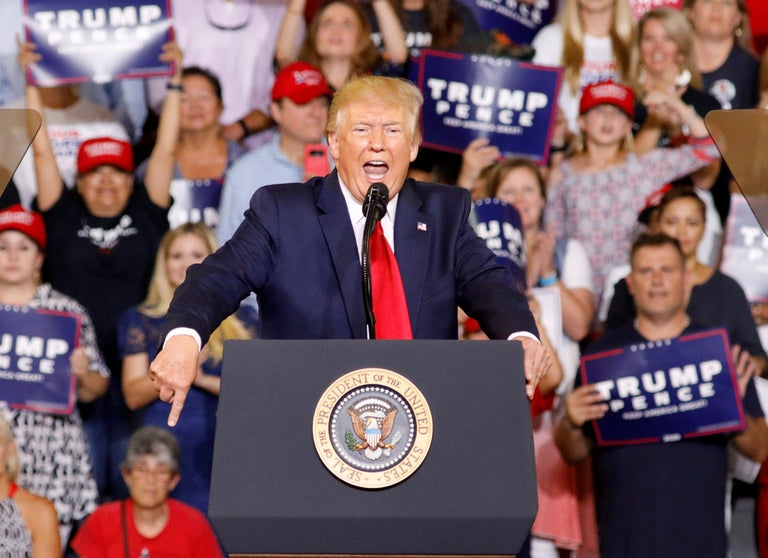 Trump supporters chant 'send her back' as president steps up racist attack on Ilhan Omar at rally