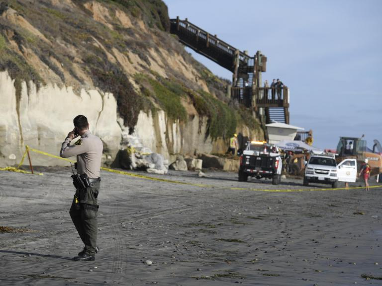 California cliff collapse: Three dead after tons of sandstone plunges onto popular surfing beach