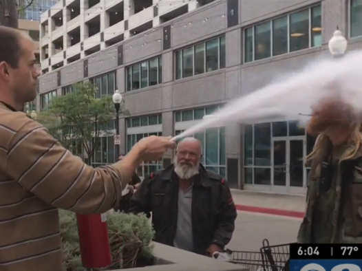 Man sprays smoker in face with fire extinguisher to put out cigarette: You cant smoke around here