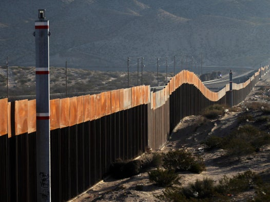 Smugglers helping migrants scale Trump's border wall 'using $5 ladders'