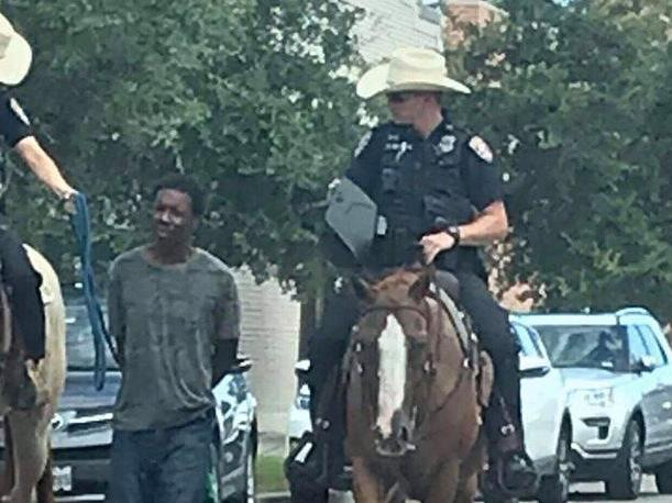 Texas police lead black man down street on end of rope