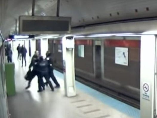Footage shows Chicago police shooting unarmed man twice on subway escalator