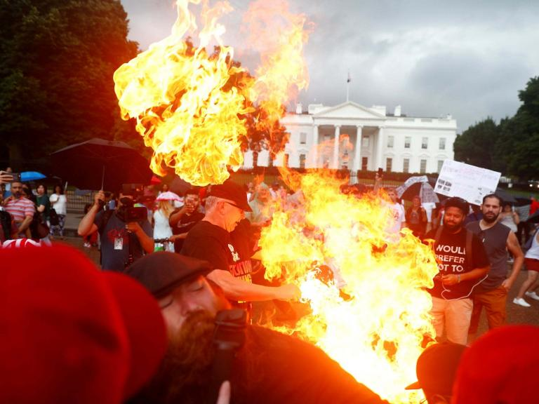 Trump fans in violent clashes with communists after American flag burned outside White House during 4th of July celebrations