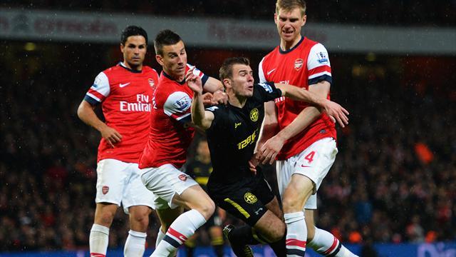 Premier League - Arsenal condemn Wigan to relegation