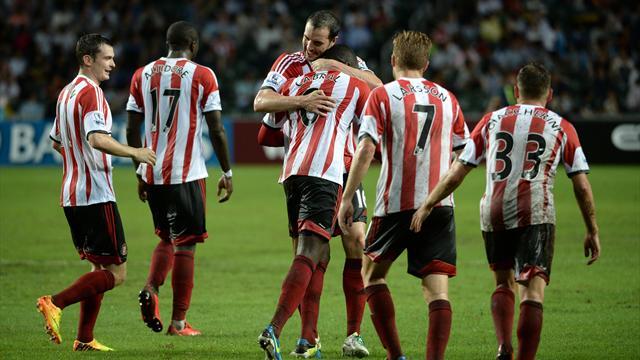 Premier League - Sunderland down Spurs in wet Hong Kong