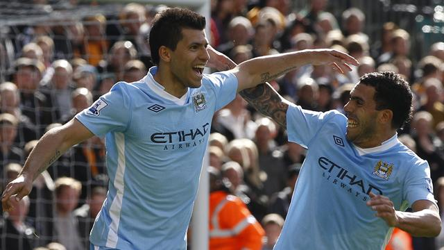 City send Wolves down, close on United
