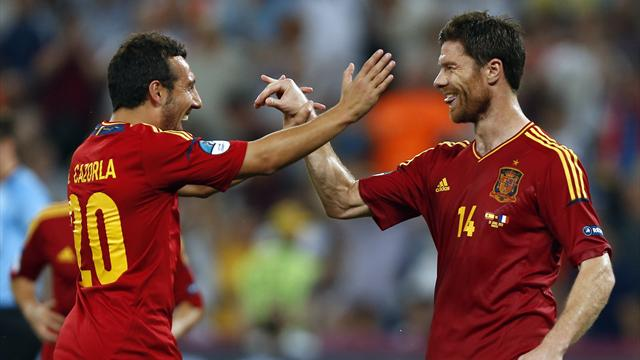 Centurion Alonso sends Spain into semis