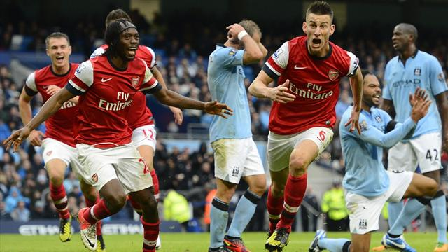 Premier League - Koscielny earns Arsenal draw at Manchester City
