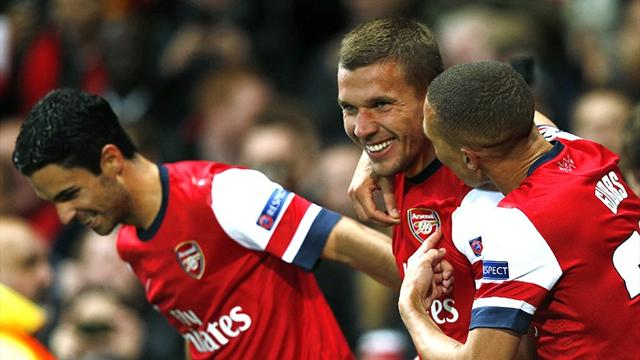 Podolski and Ramsey strike after break to seal Arsenal win