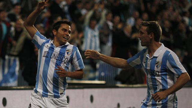 Spanish Liga - Malaga batter Granada