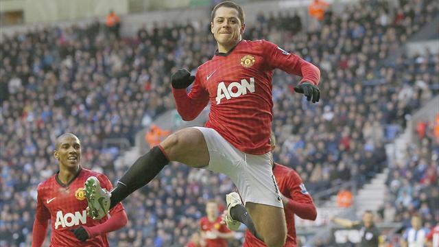 Premier League - Hernandez and Van Persie help United thump Wigan