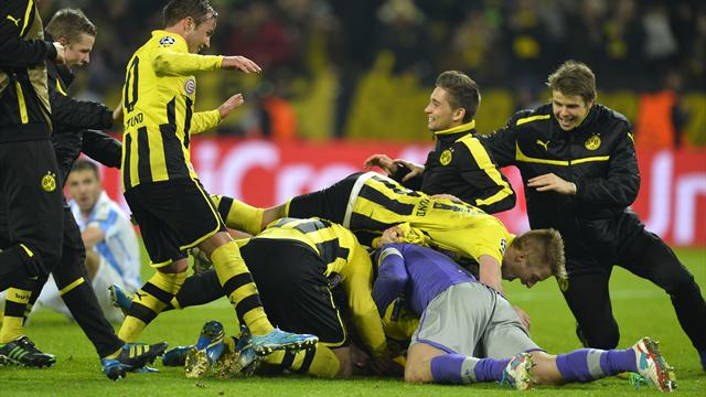 Champions League - Dortmund score two in injury time to knock out Malaga