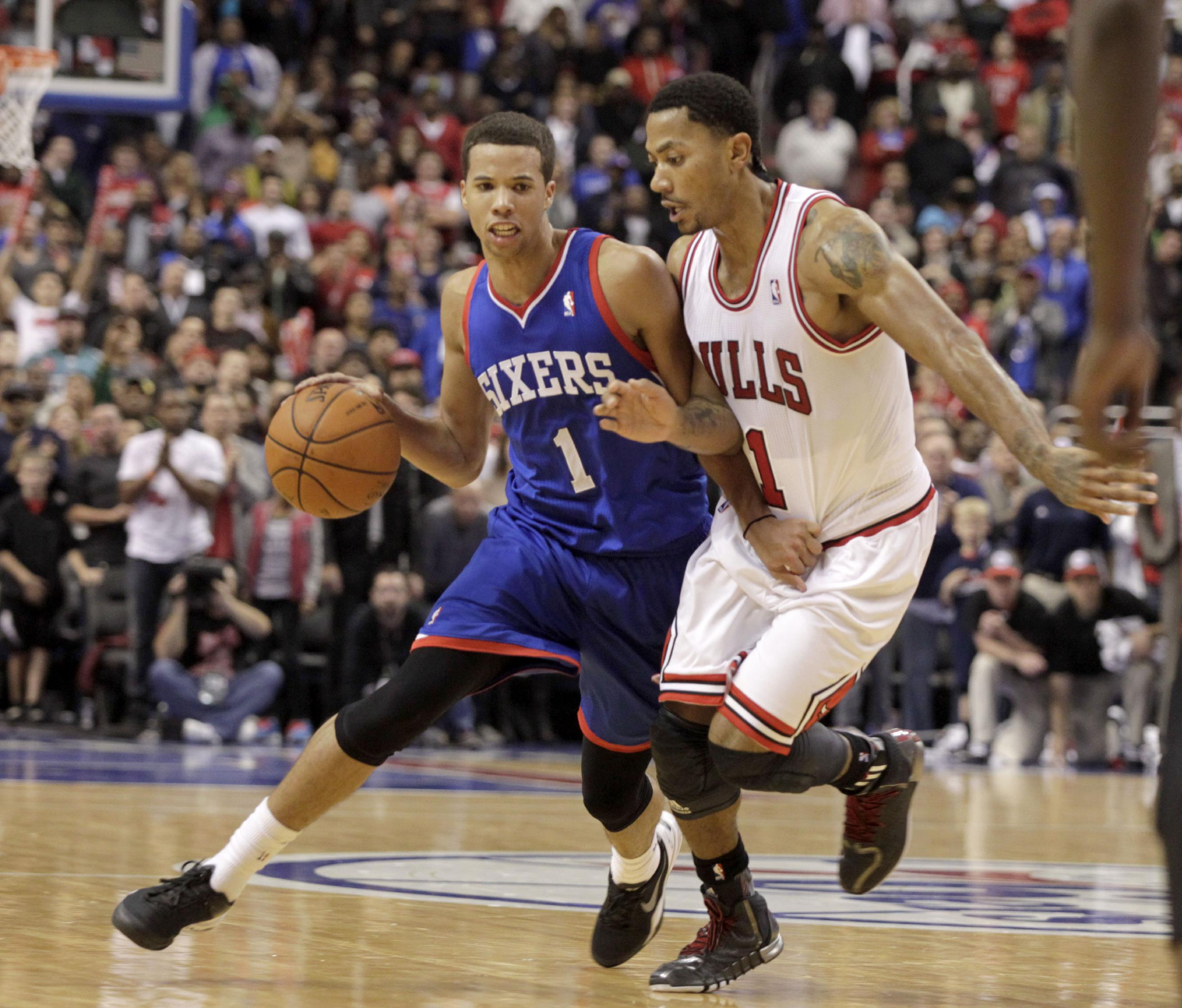 76ers win again, beat Bulls Chicago Bulls' Derrick Rose