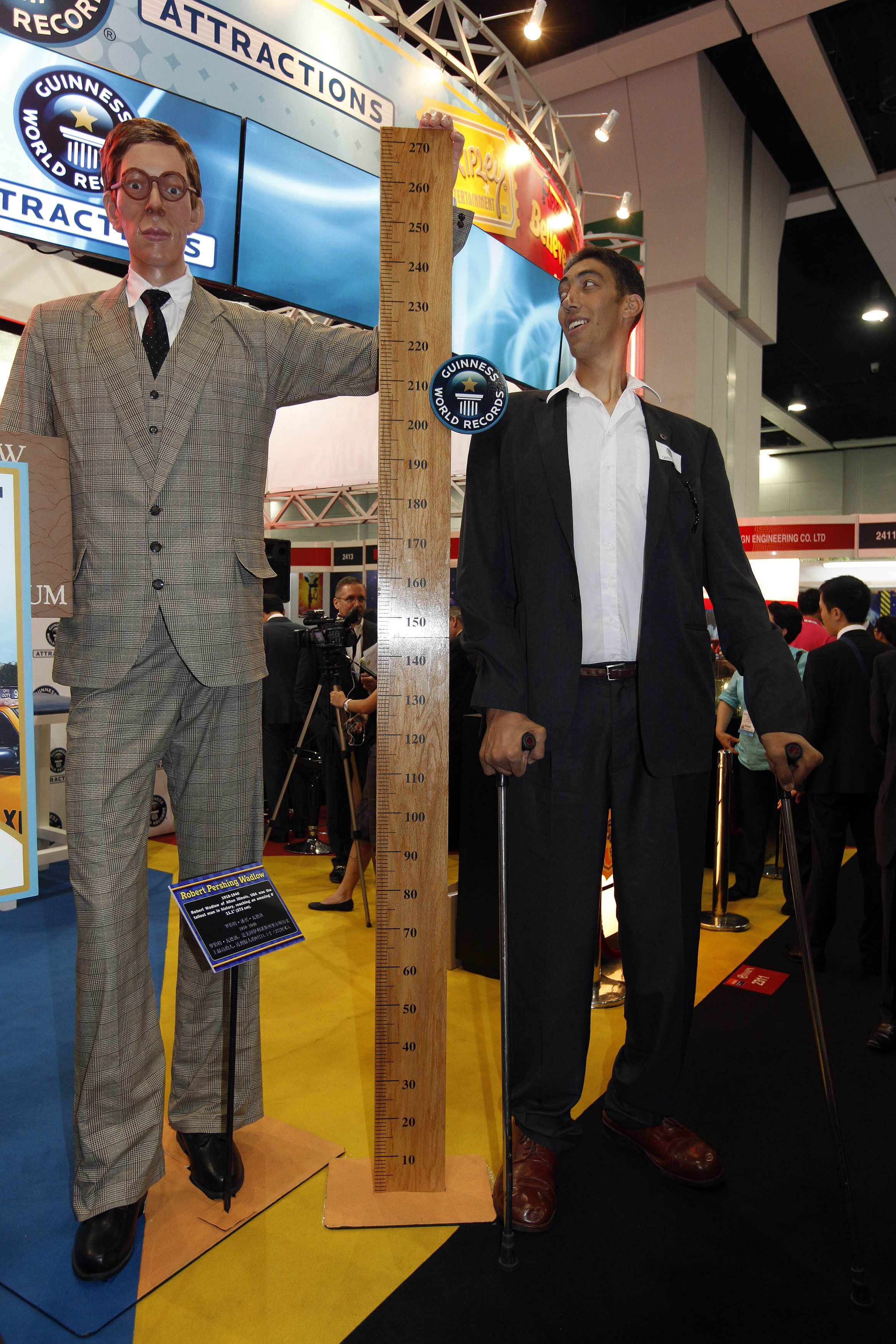 Two Tallest Men In The World Standing Next To A 60 Tall Guy Tall