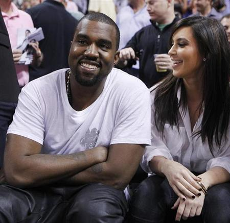 Rap musician Kanye West is seen court side with reality television star Kim Kardashian as the Miami Heat play the New York Knicks in their NBA basketball game in Miami, Florida December 6, 2012. REUTERS/Andrew Innerarity