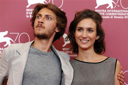 "Actors Gabriele Rendina and Livia Rossi (R) pose during a photocall for the movie ""L'Intrepido"", directed by Gianni Amelio, during the 70th Venice Film Festival in Venice September 4, 2013. REUTERS/Alessandro Bianchi"