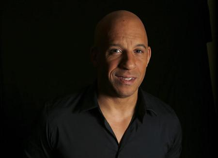 "Actor Vin Diesel poses for a portrait while promoting his upcoming movie ""Riddick"" in Los Angeles, California August 27, 2013. REUTERS/Mario Anzuoni"