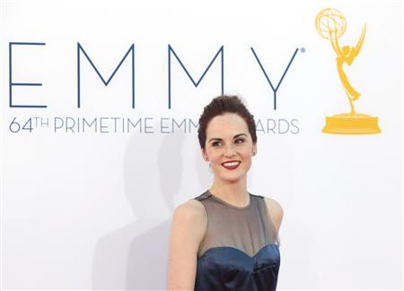 "British actress Michelle Dockery of the drama series ""Downton Abbey"" arrives at the 64th Primetime Emmy Awards in Los Angeles in this September 23, 2012 file photo. REUTERS/Mario Anzuoni/Files"