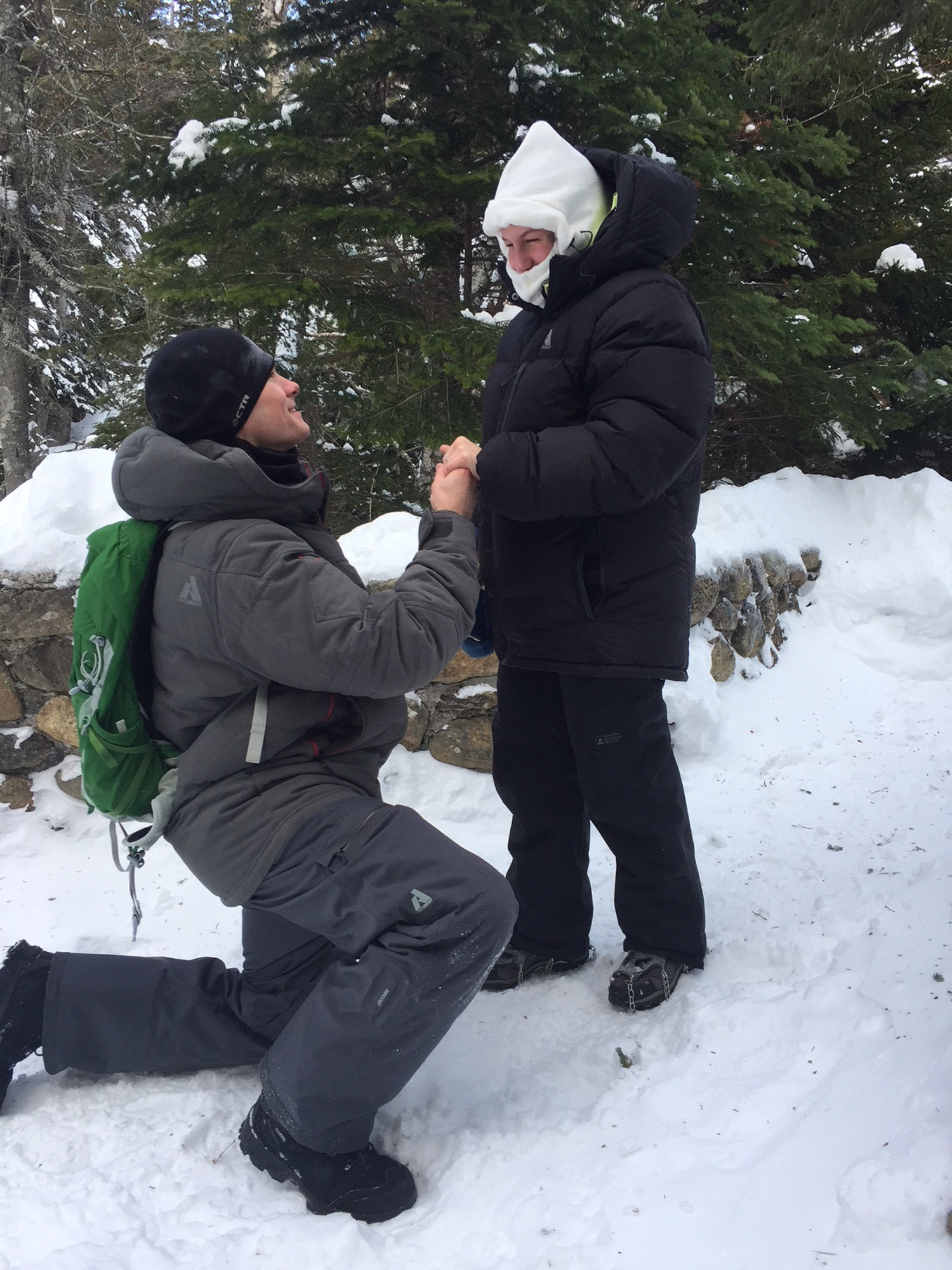 Warm hearts, subzero temps: Couple gets engaged on mountain