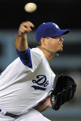 Cards edge Dodgers 2-1, extend wild-card lead