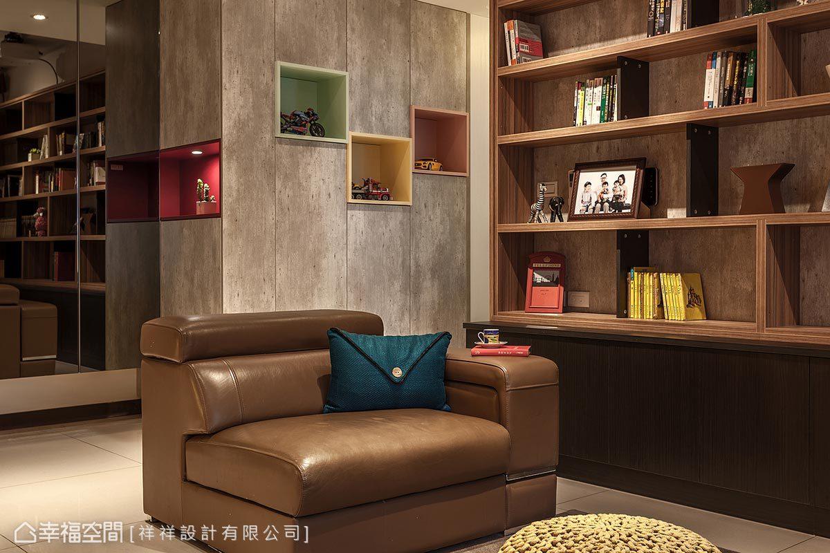 以灰棕色做為主題色調,加入木質和仿清水模材質,搭配復古沙發軟件,提升空間內Loft風格語彙。
