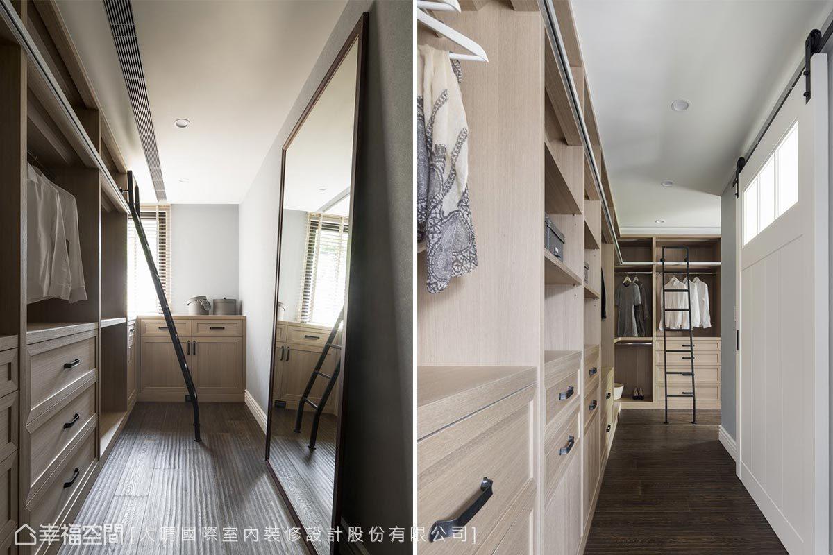 更衣室裡除了有足夠的收納機能,還利用白色穀倉門圍塑出優雅的浴室空間。