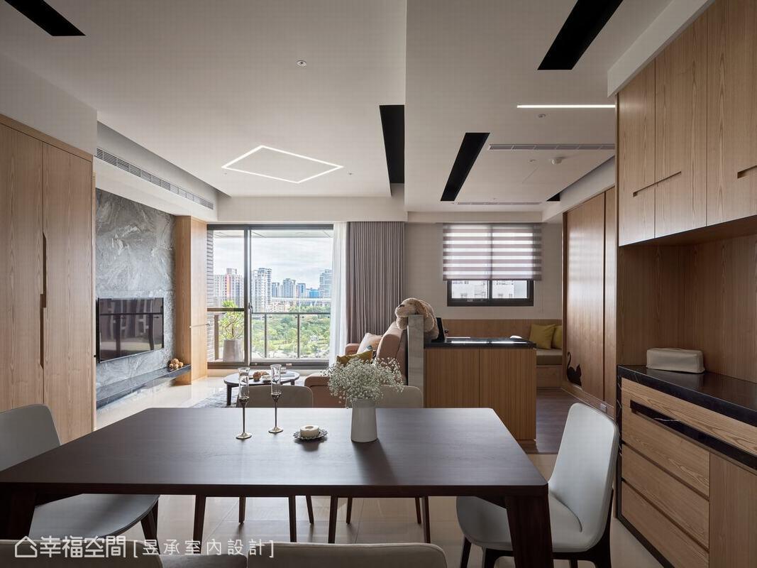 洪華山設計師捨棄傳統嵌燈法,以LED線燈呈現不同的線條表現,完美透露現代空間的簡潔俐落。