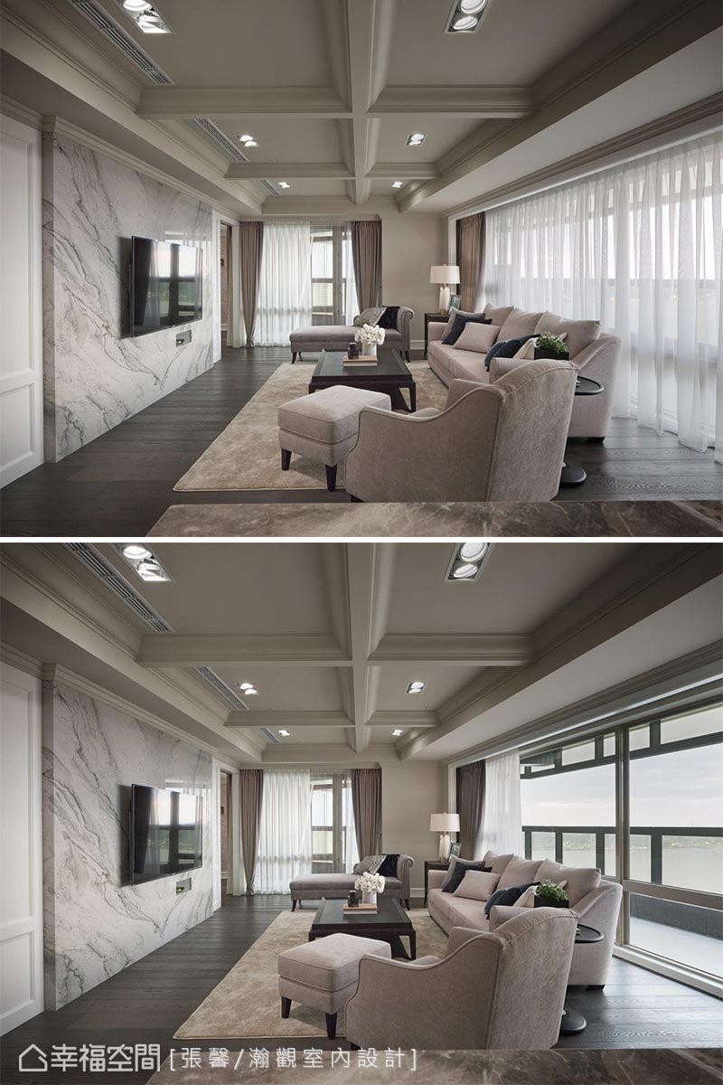 電視牆選用了帶點墨綠色的大理石,整個公區用的是霧鄉白的線板勾勒線條,讓空間感溫暖又柔和。