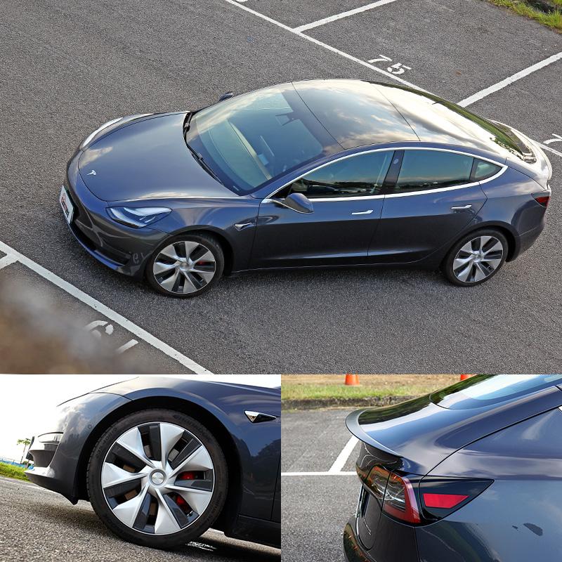 Model 3外型依循Tesla一貫的簡潔風格,而19吋胎圈組與碳纖維後尾翼是Performance車型專屬配備。