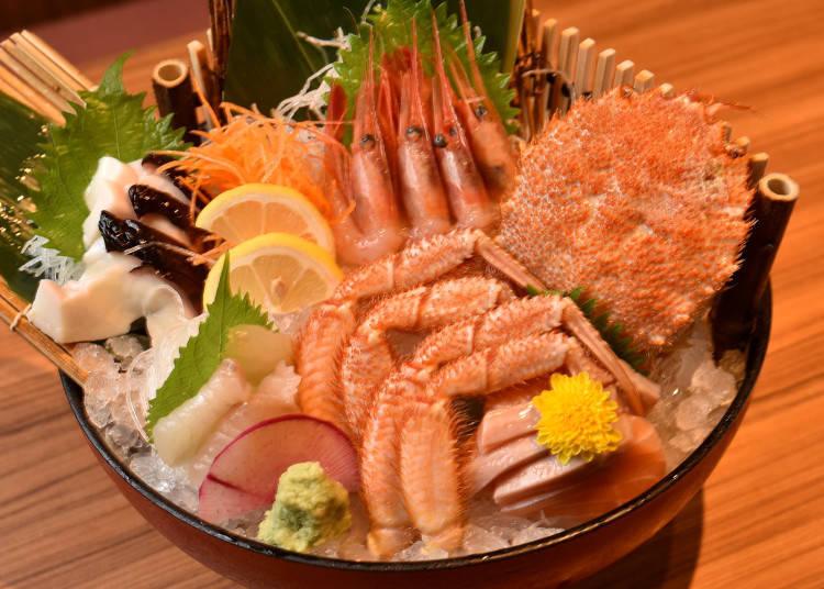 吃到飽方案中有毛蟹的五樣綜合生魚片。